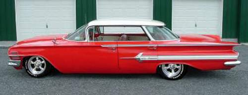 1960 Impala in red with torque thrusts